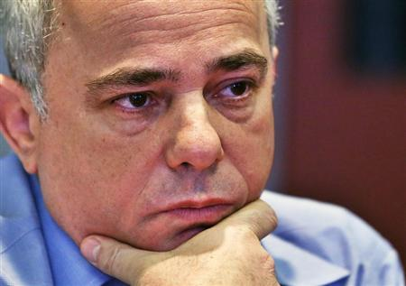 Israeli Finance Minister Yuval Steinitz listens to a question during an interview in New York January 28, 2013. REUTERS/Shannon Stapleton