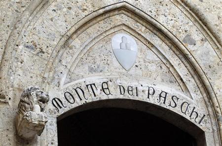 The Monte dei Paschi bank logo is seen on the main entrance of the bank's headquarters in Siena March 12, 2012. REUTERS/Max Rossi