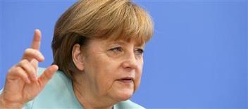 German Chancellor Angela Merkel gestures during a news conference at Bundespressekonferenz in Berlin July 19, 2013. REUTERS/Tobias Schwarz