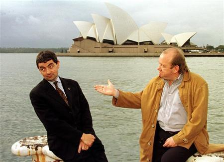 English comedian and actor Rowan Atkinson (L) and compatriot Mel Smith (R) pose for photographers with Sydney's famous landmark the Opera House behind after a news conference July 3. Reuters photographer