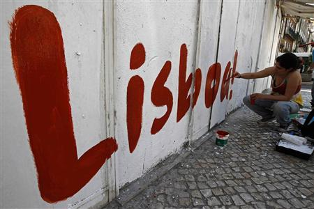 A political activist paints the word ''Lisbon'' on a wall at a street in Lisbon July 20, 2013. REUTERS/Jose Manuel Ribeiro