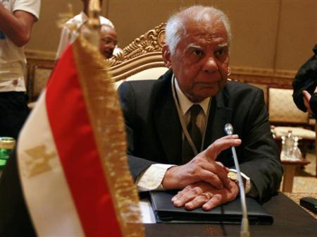 Egypt's Finance Minister Hazem el-Beblawi looks on during a group meeting of Gulf and Arab Finance Ministers in Abu Dhabi, in this September 7, 2011 file photo. REUTERS/Jumana El Heloueh/Files