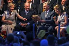 Belgium's King Albert II (2nd L), Queen Paola (L), Crown Prince Philippe (2nd R) and Crown Princess Mathilde attend the national ball in the Marolles district to celebrate King Albert II's 20th anniversary of reign, in Brussels July 20, 2013. REUTERS/Yves Herman
