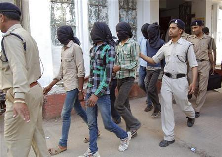 Police escort men accused of a gang rape to a court in Datia district in Madhya Pradesh March 18, 2013. REUTERS/Stringer/Files