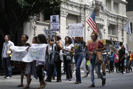 Protesters march during a demonstration against the verdict in the George Zimmerman trial, in Los Angeles July 20, 2013. REUTERS/David McNew