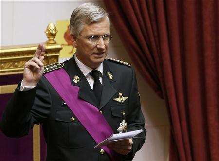 King Philippe of Belgium takes the oath during a ceremony at the Belgian Parliament in Brussels July 21, 2013. Belgium is celebrating its National Day, which also marks the abdication of King Albert II of Belgium and the investiture of his eldest son Philippe. REUTERS/Vincent Kessler