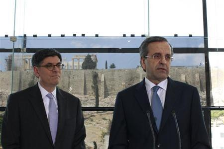 Greece's Prime Minister Antonis Samaras (R) addresses reporters next to U.S. Treasury Secretary Jack Lew at the Athens Acropolis Museum in Athens July 21, 2013. REUTERS/Kostas Tsironis/Pool