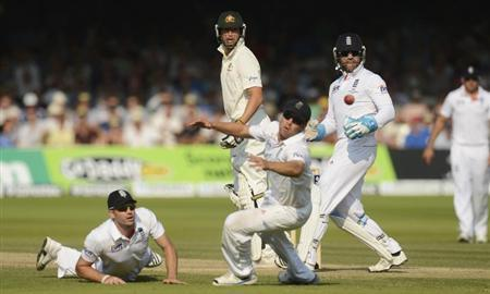 Australia's James Pattinson (2nd L) watches as he is dropped by James Anderson (left) as Jonathan Trott (3rd L) tries to reach the ball during the second Ashes cricket test match at Lord's cricket ground in London July 21, 2013. REUTERS/Philip Brown