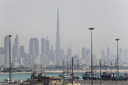 The skyline is seen with the Burj Khalifa as ships dock at Port Rashid, in Dubai May 26, 2013. REUTERS/Ahmed Jadallah/Files