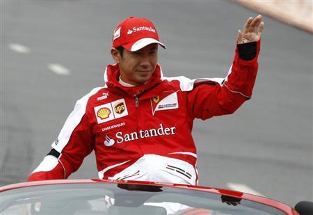 Ferrari Formula One test pilot Kamui Kobayashi waves to spectators during the Moscow City Racing event in Moscow July 21, 2013. REUTERS/Sergei Karpukhin