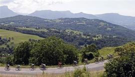 Le 100e Tour de France s'est offert une ouverture sur le monde qui laissera le souvenir d'une compétition intéressante, de la mainmise de Christopher Froome et de l'avantage pris par les pays émergents du cyclisme sur ses nations fondatrices. /Photo prise le 20 juillet 2013/REUTERS/Jean-Paul Pelissier