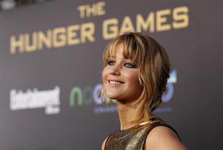 Cast member Jennifer Lawrence poses at the premiere of ''The Hunger Games'' at Nokia theatre in Los Angeles, California March 12, 2012. REUTERS/Mario Anzuoni