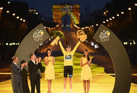 Team Sky rider and leader's yellow jersey holder Christopher Froome of Britain, winner of the centenary Tour de France cycling race, celebrates his overall victory on the podium after the 133.5km final stage, from Versailles to Paris Champs Elysees, July 21, 2013. REUTERS/Bernard Papon/Pool