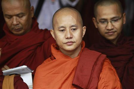 Buddhist monk Wirathu (C), leader of the 969 movement, attends a meeting on the National Protection Law at a monastery outside Yangon, in this June 27, 2013 file picture. REUTERS/Soe Zeya Tun