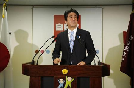 Japan's Prime Minister and the leader of the ruling Liberal Democratic Party (LDP), Shinzo Abe, makes an appearance before the media at a news conference following a victory in the upper house elections by his ruling coalition, at the LDP headquarters in Tokyo July 22, 2013. REUTERS/Issei Kato
