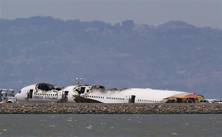 The charred remains of the Asiana Airlines flight 214 sits on the runway at San Francisco International Airport in San Francisco, California July 9, 2013. REUTERS/Jed Jacobsohn