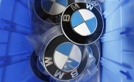BMW luxury car logos are pictured in a spare part store at a BMW garage in Niderwangen near Bern, May 24, 2012. REUTERS/Pascal Lauener