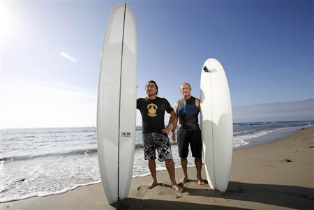 Australian surfers Ross Clark-Jones (L) and Tom Carroll pose for a picture while promoting their upcoming documentary ''Storm Surfers 3D'' at Malibu Lagoon State Beach in Malibu, California July 18, 2013. REUTERS/Mario Anzuoni