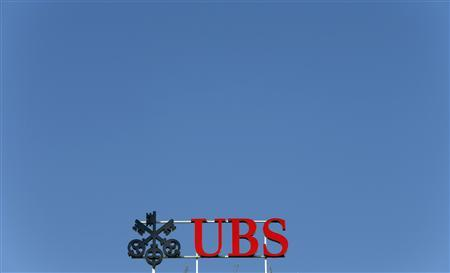 The logo of Swiss bank UBS is seen on an office building in Zurich July 22, 2013. UBS said on Monday it settled a Federal Housing Finance Agency lawsuit over soured mortgage investments, taking an 865 million Swiss franc ($919.63 million) charge against second-quarter earnings for litigation, impairments and other provisions. REUTERS/Arnd Wiegmann