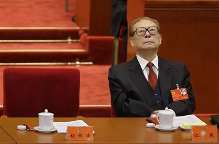 China's former President Jiang Zemin looks up while President Hu Jintao gives his speech during the opening ceremony of 18th National Congress of the Communist Party of China at the Great Hall of the People in Beijing, November 8, 2012. REUTERS/Jason Lee/Files