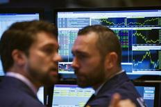 Traders work on the floor of the New York Stock Exchange shortly after the markets opening in New York, July 22, 2013. REUTERS/Lucas Jackson