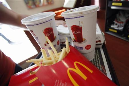 A man holds a tray of food at a McDonald's restaurant in Times Square, New York in this May 31, 2012 file photo. REUTERS/Mike Segar/Files