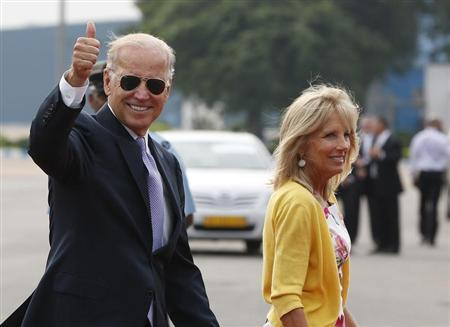 U.S. Vice President Joe Biden gestures as he and his wife Jill (R) arrive at the airport in New Delhi July 22, 2013. Biden is on a four-day visit to India. REUTERS/Adnan Abidi