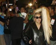 U.S. singer Lady Gaga poses for photographers upon arrival for her concert in Manila May 19, 2012. REUTERS/Cheryl Ravelo