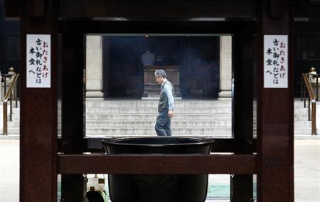 A man walks past an entrance to a temple in Tokyo's Sugamo district June 26, 2013. REUTERS/Yuya Shino/Files