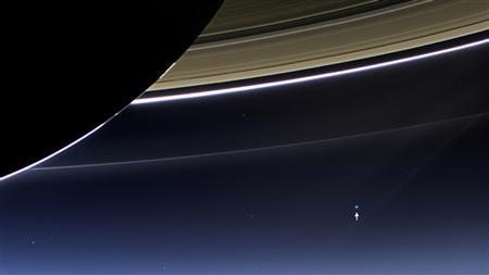 The wide-angle camera on NASA's Cassini spacecraft has captured Saturn's rings and planet Earth and its moon in the same frame in this rare image taken on July 19, 2013 courtesy of NASA. REUTERS/NASA/Handout via Reuters