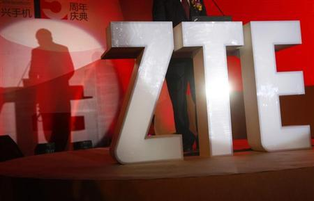 The ZTE company logo is seen as a guest delivers a speech during the company's 15th anniversary celebration in Beijing April 18, 2013.REUTERS/Barry Huang