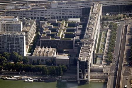 An aerial view shows France's Ministry of Economy, Industry and Jobs, referred to as Bercy, and the Seine River in Paris July 14, 2013. REUTERS/Charles Platiau