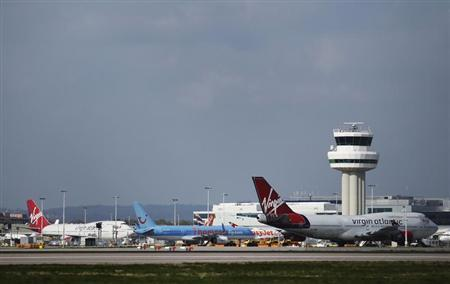Passenger airplanes are seen grounded at Gatwick Airport in London April 16, 2010. REUTERS/Luke MacGregor
