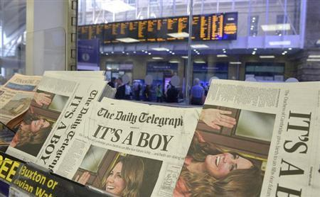 Newspapers displaying announcing the Royal birth by Britain's Catherine, Duchess of Cambridge are seen for sale in central London, July 23, 2013. REUTERS/Paul Hackett
