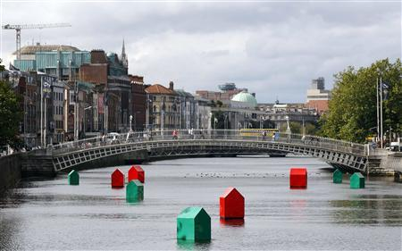 An art installation of Monopoly houses and hotels by Irish contemporary artist Fergal McCarthy floats on the River Liffey in Dublin, in this September 21, 2010 file picture. REUTERS/Cathal McNaughton/Files