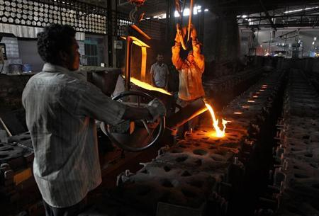 Workers tend to a furnace at a steel factory in the outskirts of Coimbatore, about 500 km from the Chennai, January 7, 2013. REUTERS/Babu/Files