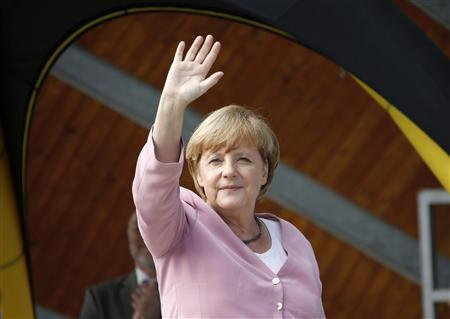 German Chancellor Angela Merkel waves during a Christian Democratic Union (CDU) election campaign rally in Heringsdorf at the Baltic sea July 22, 2013. REUTERS/Fabrizio Bensch