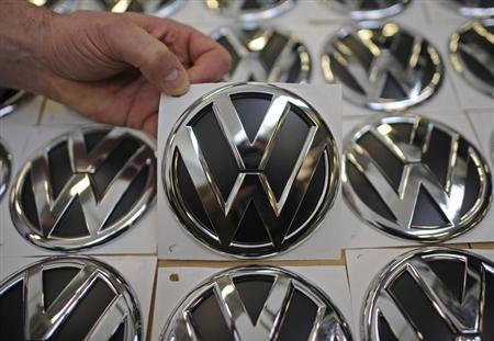 VW emblems are presented in a production line at the plant of German carmaker Volkswagen in Wolfsburg, March 7, 2012. REUTERS/Fabian Bimmer