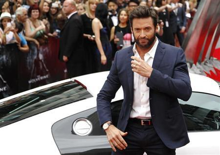Actor Hugh Jackman poses as he arrives at the UK Premiere of ''The Wolverine'' at Leicester Square in London July 16, 2013. REUTERS/Luke MacGregor