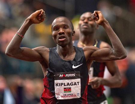 Silas Kiplagat of Kenya reacts at the finish line after beating Bernard Lagat (rear) of the U.S. in the men's 1 mile run at the US Open Track and Field meet at Madison Square Garden in New York, January 28, 2012. REUTERS/Ray Stubblebine
