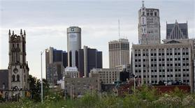 Downtown Detroit, including the General Motors World Headquarters (2nd L), is pictured from a vacant lot along Woodward Avenue in Detroit, Michigan in this July 21, 2013, file photo. REUTERS/Rebecca Cook/Files