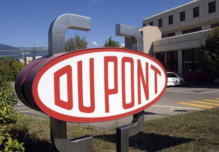 A DuPont logo is pictured on the research center in Meyrin near Geneva in this August 4, 2009 file photo. REUTERS/Denis Balibouse