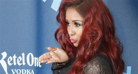 TV personality Nicole ''Snooki'' Polizzi arrives for the 24th Annual GLAAD Media Awards in New York, March 16, 2013. REUTERS/Carlo Allegri