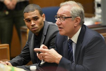 Singer Chris Brown (L) and attorney Mark Geragos attend a probation progress hearing in Los Angeles Superior Court July 15, 2013. REUTERS/Alberto E. Rodriguez/Pool