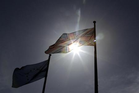 The Union Jack and the EU flags fly in Ashford, southern England April 30, 2013. REUTERS/Stefan Wermuth