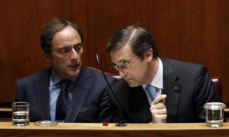 Portugal's Prime Minister Pedro Passos Coelho (R) listens to Paulo Portas during a no-confidence session at parliament in Lisbon July 18, 2013. REUTERS/Hugo Correia