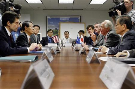 The Executive Board of the Korean Peninsula Energy Developement Organization (KEDO) including Joseph DeTrani (L) of the United States, Sun-Sup Chang (2nd L) of South Korea, Katsunari Suzuki of Japan (R) and Jean Pierre Leng (2nd R) of the European Union, talk at the start of a routine meeing in New York, May 20, 2004. REUTERS/Peter Morgan