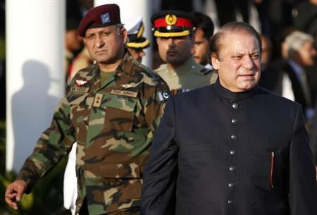 Pakistan's newly elected Prime Minister Nawaz Sharif (R) arrives to inspect the guard of honor during a ceremony at the prime minister's residence after being sworn-in, in Islamabad June 5, 2013. REUTERS/Mian Khursheed/Files