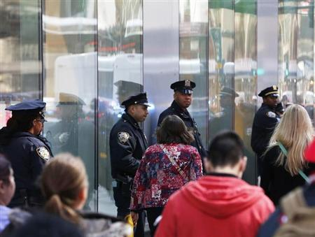 New York Police Department officers stand in the Times Square in New York, April 25, 2013. REUTERS/Brendan McDermid