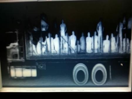 Illegal immigrants from Central America, Nepal and Bangladesh are seen in a trailer truck after being detected by police X-ray equipment at a checkpoint in La Pochota outside Tuxtla Gutierrez, capital of Mexico's Chiapas State, in this July 23, 2013 handout X-ray image provided by the Attorney General's Office (PGR) of Chiapas State. REUTERS/Attorney General's Office/Handout